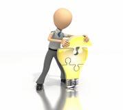 Figura di affari che sviluppa puzzle della lampadina Fotografie Stock Libere da Diritti