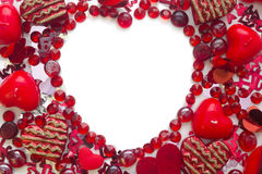 Figura di cuore fatta con i coriandoli ed i cristalli Fotografia Stock