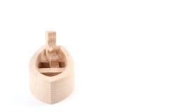 Figura di legno del giocattolo nella barca fotografie stock libere da diritti