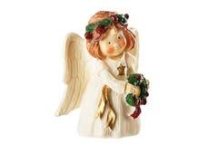 Figura di piccolo angelo con la corona in mani, decorat di natale Fotografia Stock