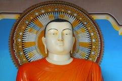 Figura di seduta del Buddha Immagini Stock