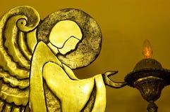 Figura dorata dell'angelo Fotografia Stock