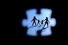 Figura enigma da família de serra de vaivém da calha Foto de Stock Royalty Free