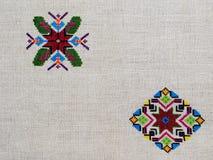 Figura estrela do ornamento do bordado da pastilha do rombo do diamante da lona do cânhamo fotografia de stock