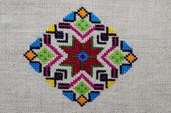 Figura estrela do ornamento do bordado da pastilha do rombo do diamante da lona do cânhamo Foto de Stock