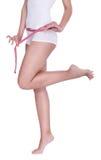Figura femenina delgada con la cinta de medición Imágenes de archivo libres de regalías