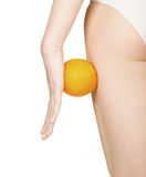 Figura femenina hermosa con la naranja Fotos de archivo libres de regalías