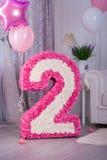 Figura festiva 2 due dai tovaglioli rosa Immagine Stock
