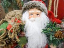 Figura giocattolo del Babbo Natale pronto per le feste Immagine Stock