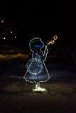 Figura illuminata di angelo alla notte di Natale Immagini Stock Libere da Diritti