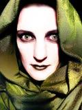 Figura malvada encapuchada ojos del amarillo Imagen de archivo