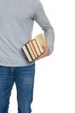 Figura maschio con i libri in mani Fotografia Stock