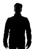 Figura masculina en la silueta que lleva un chaleco Imágenes de archivo libres de regalías