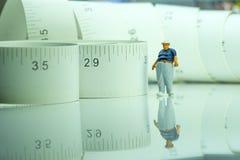 Figura miniatura di un uomo obeso Immagini Stock Libere da Diritti