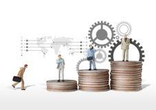 Figura miniatura idea dell'uomo di affari di concetto a successo Immagine Stock