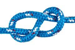 Figura oito nó de escalada na corda azul Foto de Stock Royalty Free