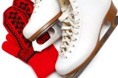 Figura patins e mittens imagens de stock