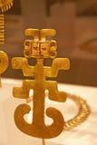 Figura pendiente, oro del molde Fotos de archivo