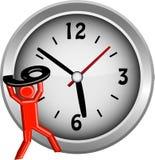 Figura roja que levanta el número 9 sobre una cara de reloj Imagen de archivo