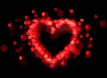 Figura rossa del cuore del bokeh Fotografie Stock