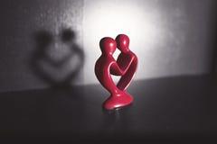 Figura rossa, nera e bianca di amore Immagini Stock