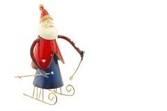 Figura velha de Santa Claus do metal do vintage em um trenó Imagem de Stock