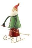 Figura velha de Santa Claus do metal do vintage em um trenó Foto de Stock Royalty Free