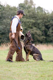 Figurant and German shepherd at work Stock Photography