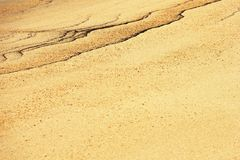 Figuras abstractas en la arena Foto de archivo libre de regalías