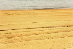 Figuras abstractas en la arena Imagen de archivo libre de regalías