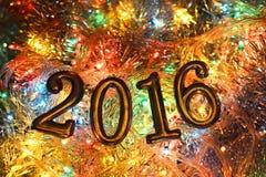 Figuras 2016 (ano novo, Natal) em luzes brilhantes Foto de Stock