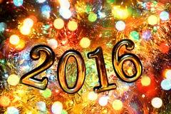 Figuras 2016 (ano novo, Natal) em luzes brilhantes Fotografia de Stock Royalty Free