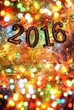 Figuras 2016 (ano novo, Natal) em luzes brilhantes Imagem de Stock