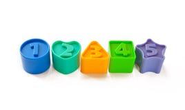 Figuras coloreadas con los números en la tapa Imagen de archivo libre de regalías