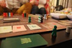 Figuras coloridas del juego a bordo Fotografía de archivo libre de regalías