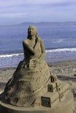 Figuras da areia na praia Imagem de Stock