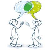 Figuras da vara na conversação e em uma interseção de duas bolhas do discurso ilustração stock