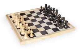 Figuras da xadrez em jogar a placa Imagens de Stock Royalty Free