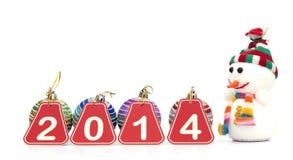 figuras de 2014 años con las bolas de la Navidad Imágenes de archivo libres de regalías