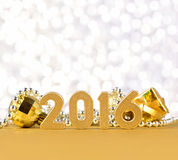 figuras de 2016 anos e decorações douradas do Natal Imagens de Stock Royalty Free