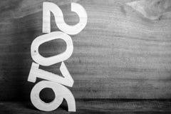 Figuras de madeira 2016 no fundo de madeira cinzento toned Imagens de Stock Royalty Free