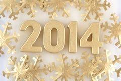figuras de oro de 2014 años Fotos de archivo