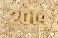 figuras de oro de 2014 años Imagenes de archivo