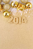 figuras de oro de 2014 años Foto de archivo