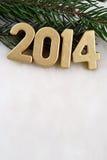 figuras de oro de 2014 años Imágenes de archivo libres de regalías