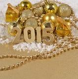 figuras de oro de 2015 años Imagen de archivo libre de regalías