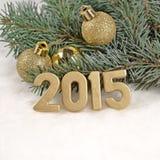 figuras de oro de 2015 años Imágenes de archivo libres de regalías