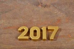 figuras de oro de 2017 años Imagen de archivo libre de regalías