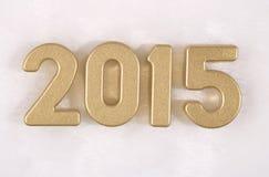 figuras de oro de 2015 años en un blanco Fotografía de archivo libre de regalías