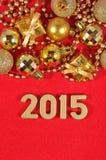 figuras de oro de 2015 años en un rojo Imágenes de archivo libres de regalías